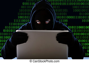 hacker man in black hood and mask with computer laptop...