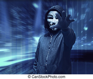 Hacker man with anonymous mask grabbing something over ...