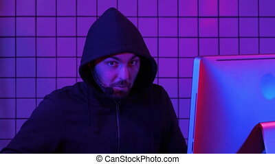 Hacker or gamer commenting on something. Professional shot...