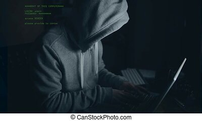 hacker password stealing - hacker working on a computer in...