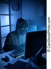 Hacker stealing data from computer - Young male thief ...