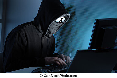 Hacker stealing data from computer