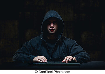Hacker stealing on internet - Picture of male hacker...