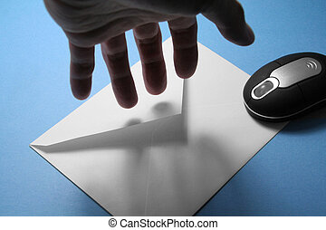 hacker - envelope and wireless mouse, concept of hacker