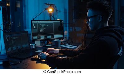 hacker using computer for cyber attack at night -...