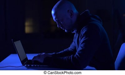 hacker using laptop computer for cyber attack - cybercrime,...