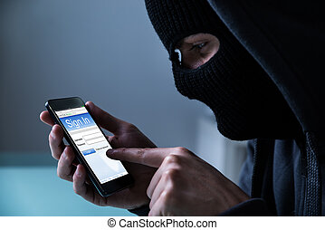 Hacker Using Smart Phone To Steal Data - Close-up Of Hacker...