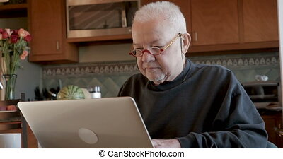 Hacker viewing an unsuspecting older man's private information on his computer