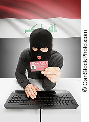 Hacker with flag on background holding ID card in hand - Iraq