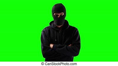 Hacker with green screen - Portrait of a Caucasian man ...