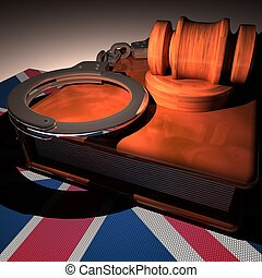 Hadcuffs, gavel and book over UK flag