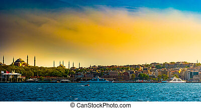 Hagia Sophia and Beautiful View touristic landmarks from sea voyage on Bosphorus. Cityscape of Istanbul at sunset.