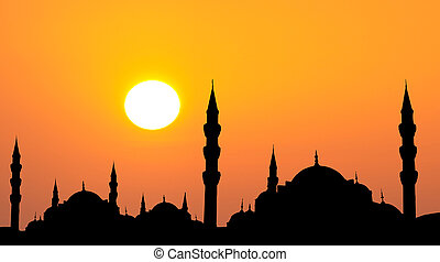 Hagia Sophia and The Blue Mosque silhouette during sunset in...