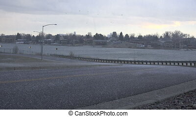 Hail on Barren Roads - Small hail falling and blowing in the...