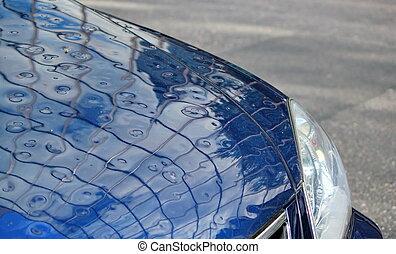 Close up on damaged car because of hail