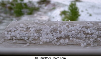Hail Outside the Window. Pieces of hail lie on the...