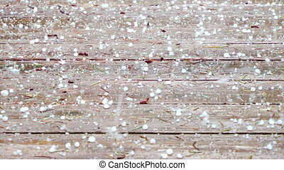 Hail Storm - Hail raining down on a wood deck, Hockinson,...