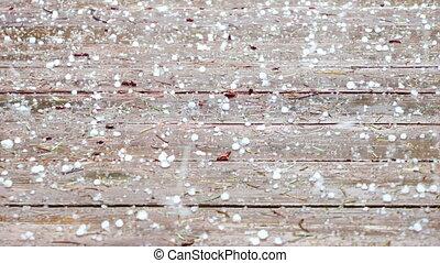 Hail Storm - Hail raining down on a wood deck, Hockinson,...