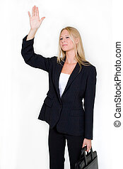 Hailing a cab - Attractive blond woman dressed in...