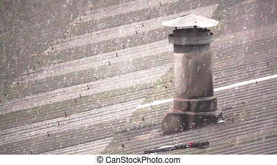 hailing over asbestos roof with chimney in super slow motion
