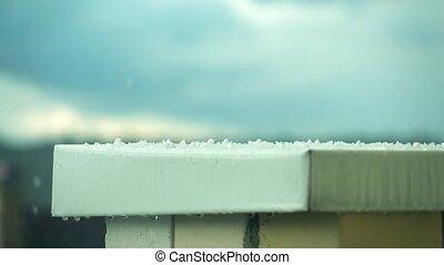 Hailstones hitting metal roof. Super slow motion shot -...