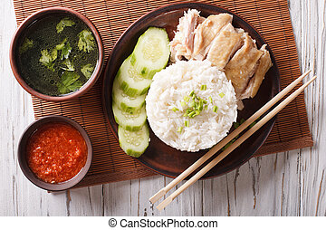 Hainanese chicken rice closeup on a plate. Horizontal top...