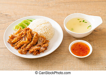 Hainanese chicken rice with fried chicken or rice steamed ...