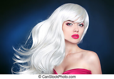 Hair. Beautiful blond girl with long wavy hair