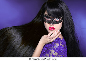 Hair. Beautiful Brunette Girl. Healthy Long glossy Hairstyle. Red lips. Beauty make-up. Mask. Manicured nail. Fashion art photo of young woman isolated on purple dark background.