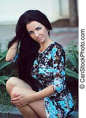 Hair. Beautiful Brunette Girl. Healthy Long Hair. Outdoors Portrait. Beauty Model Woman. Hairstyle. Hair care