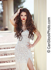 Beautiful brunette woman in fashion dress