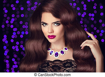 Hair. Beautiful Sexy Brunette Woman. Red Lips makeup. Healthy Long Brown wavy Hairstyle. Fashion necklace jewelry. Beauty Model Girl over party violet lights background.