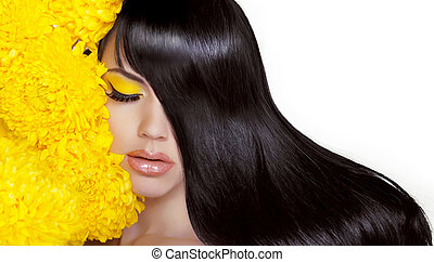 Hair. Beauty brunette Woman with Long Healthy and Shiny Smooth Hair. Model Brunette Girl Portrait with yellow flowers isolated on a white background. Gorgeous Hair