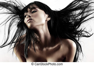 Hair blowing - Fashion model with hair blowing in the wind