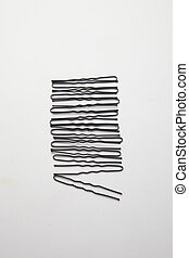 Hair Bobby Pins - hair bobby pin arranged in a row on plain...
