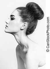 Hair bun - Black and white shot of young beautiful girl with...