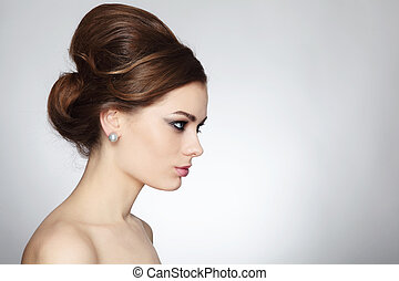 Hair bun - Profile portrait of young beautiful woman with...