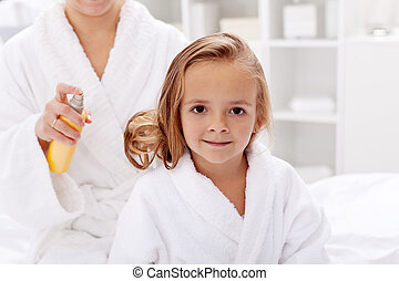 Hair care after bath - little girl having her beauty ritual