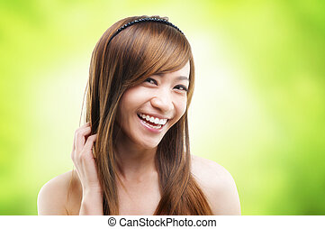 Hair care - Cheerful Asian female combing her hair using...