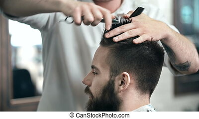 Hair Care - Face profile of a man having his hair done in...