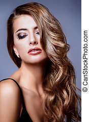hair care - Portrait of a beautiful young woman with dark...