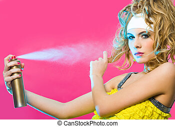 Hair care - Photo of gorgeous female spraying hair lacquer...