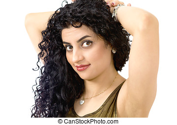 Hair care - Portrait of a woman holding up unruly hair a...