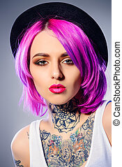 hair coloring - Bright young woman with stylish crimson hair...