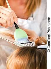 Hair coloring - Coloring hair with hair coloring brush /...