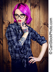 hair coloring - Cool girl with bright crimson hair and...