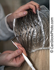 Hair coloring - Woman is being prepared for hair dyeing,...