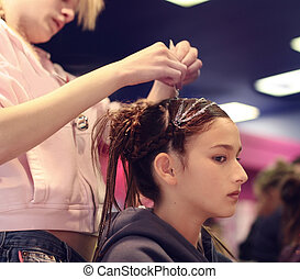 Hair design - A girl getting her hair done