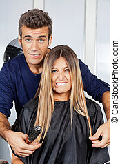 Hair Dresser And Client Making Faces - Portrait of mature...