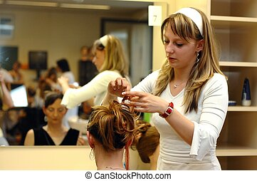 A daughter working on mother's hair at a school exam.